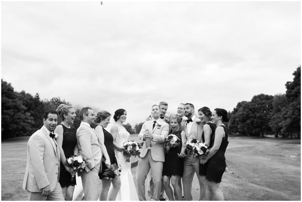 A bridal party celebrating at Golden Eagle Golf Course.