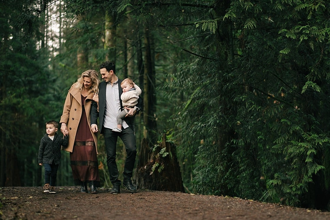 A stylishly dressed young family walk at Mundy Park in Coquitlam by Clint Bargen Photography.