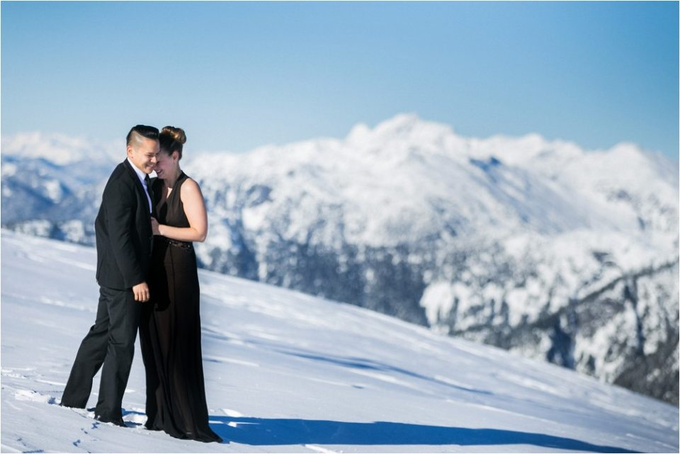A couple pose in the snow by Clint Bargen Photography.