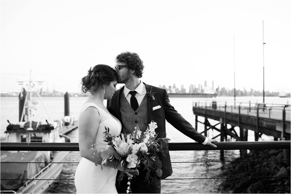 A newly married couple pose at Lonsdale Quay by Clint Bargen Photography.