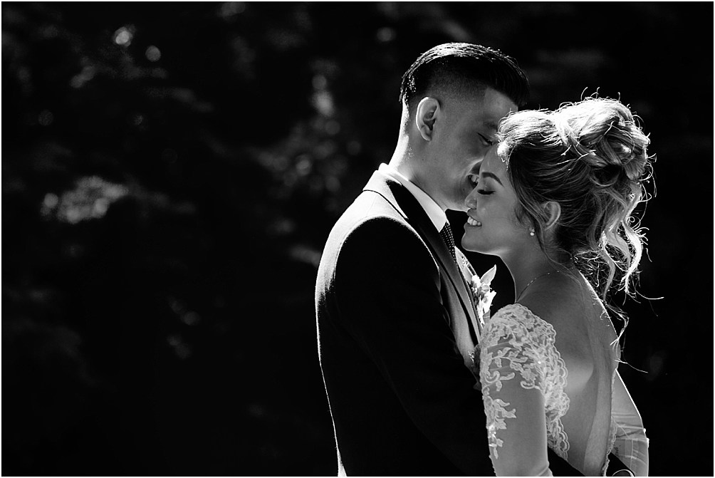 A portrait of a bride and groom embracing on their wedding day