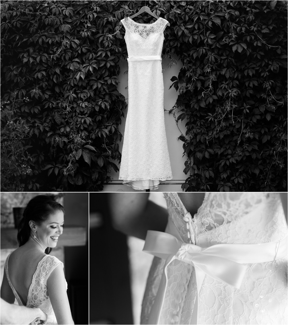 A Wedding Dress Hangs Amongst Hedge Of Leaves In Burnaby By Clint Bargen Photography