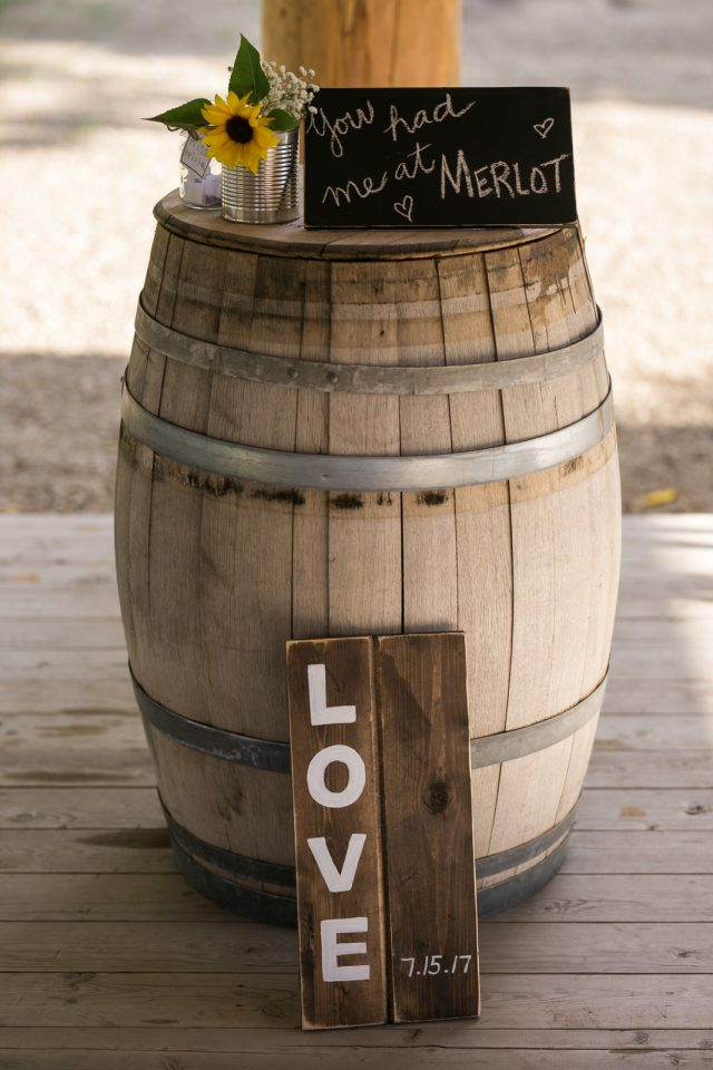 A wooden barrel with hand made wedding decorations at Covert Farms Winery near Oliver, BC. Photo by Clint Bargen Photography.