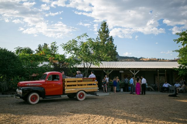 A view of a classic red pickup truck and the winery at Covert Farms Winery near Oliver, BC. Photo by Clint Bargen Photography.
