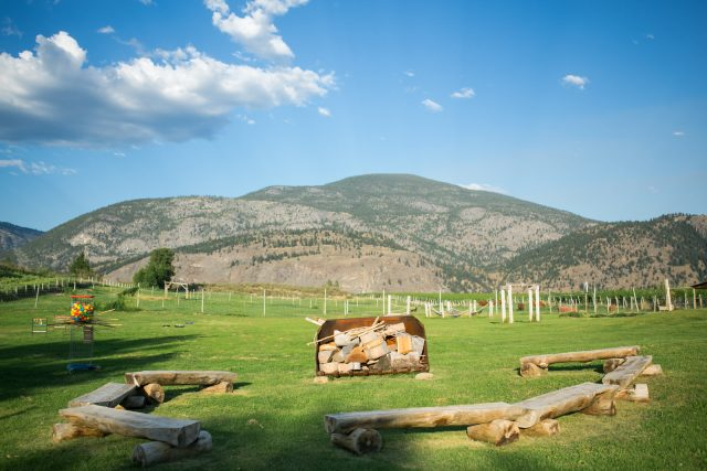 The view of the pasture, fire pit and yard games near Olivier, BC at Covert Farms. Photo by Clint Bargen Photography.