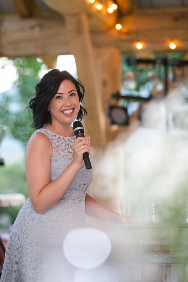 A maid of honor in a purple dress gives a wedding speech near Olivier, BC at Covert Farms. Photo by Clint Bargen Photography.
