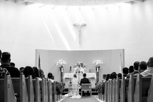 A priest performs a wedding ceremony at St. Mary's Parish in Burnaby, BC. Photo by Clint Bargen Photography.