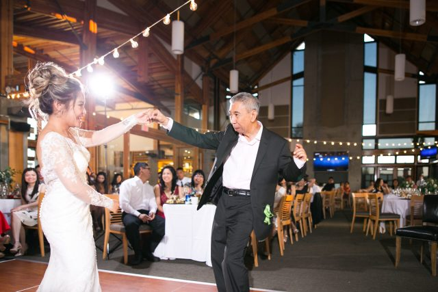 A bride dances with her father at Riverway Golf Course in Burnaby, BC.