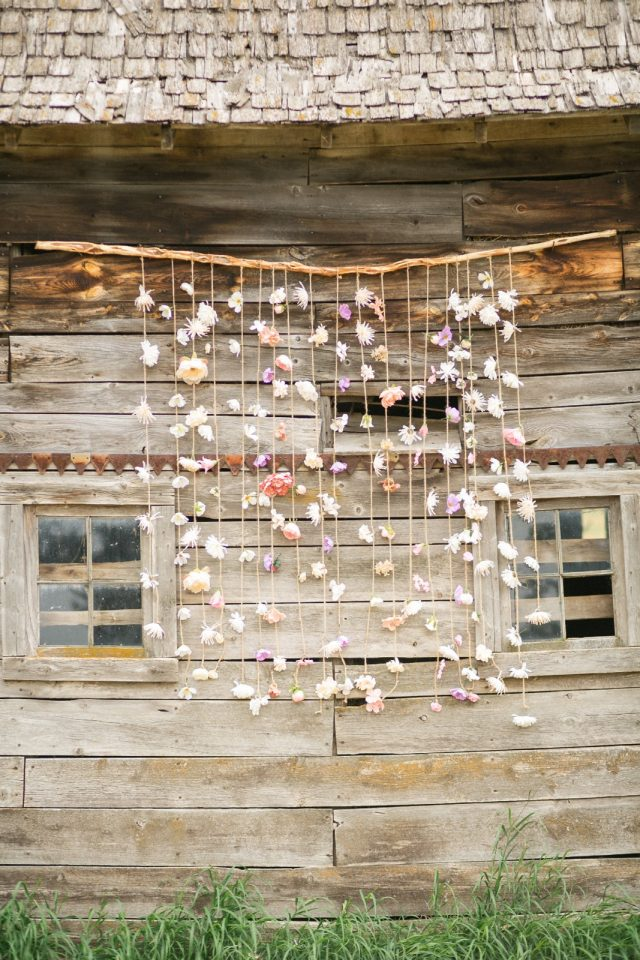 A ribbon wall hangs on an old rustic barn in Saskatchewan.