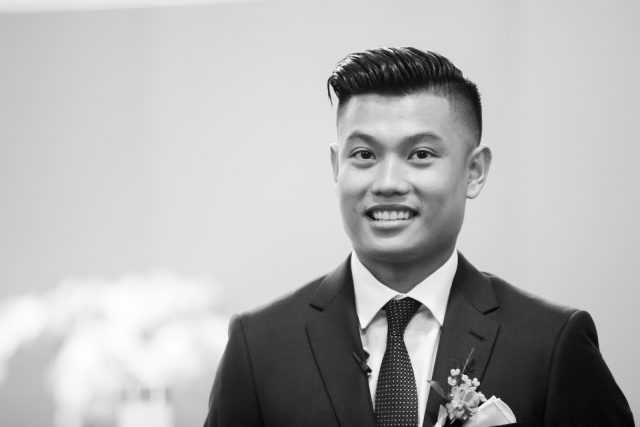 A groom reacts to seeing his bride in her wedding dress for the first time at St. Mary's Parish in Burnaby, BC. Photo by Clint Bargen Photography.