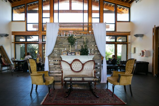 Vintage furniture and decor sit in the lobby at Riverway Golf Course in Burnaby, BC. Photo by Clint Bargen Photography.