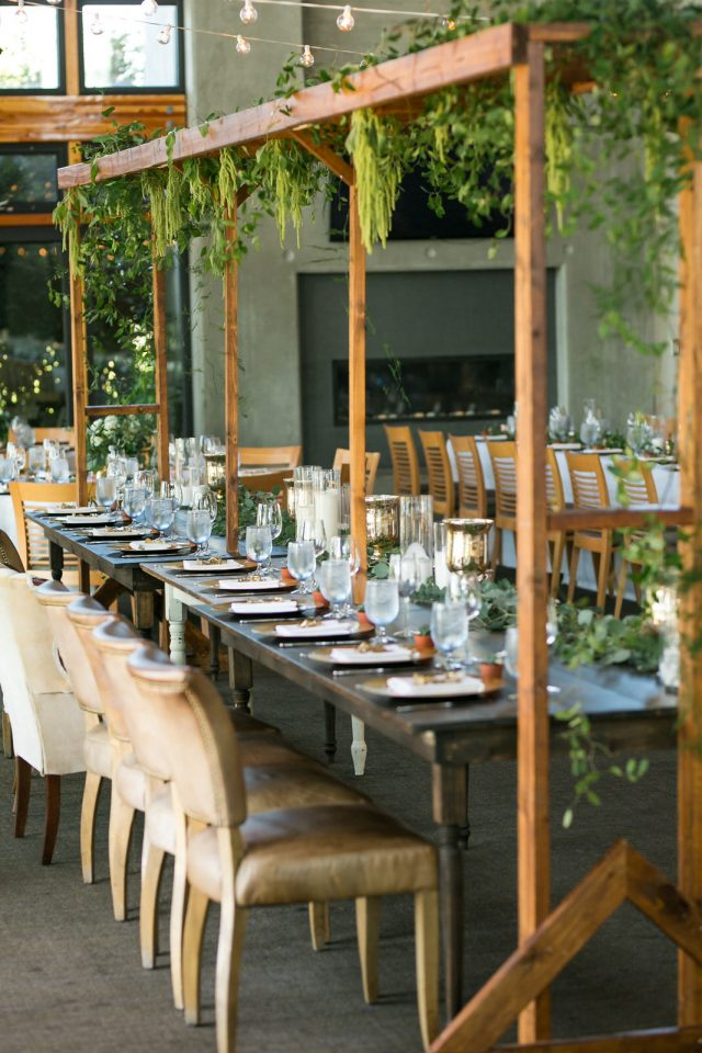 Wooden table and gorgeous rustic wedding decor at Riverway Golf Course in Burnaby, BC. Photo by Clint Bargen Photography.