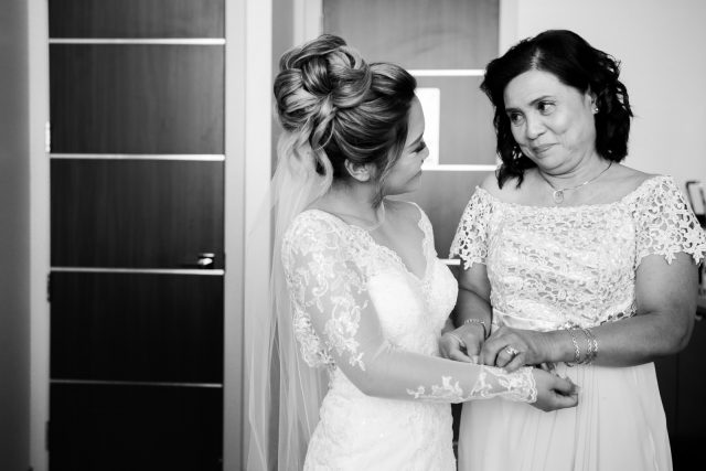 A bride and her mom exchange a smile at Delta Marriott Hotel in Burnaby, BC.